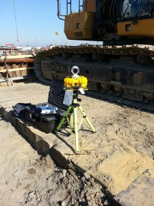 HoistCam HC160 Mounted on Tripod next to Excavator with Transport Case